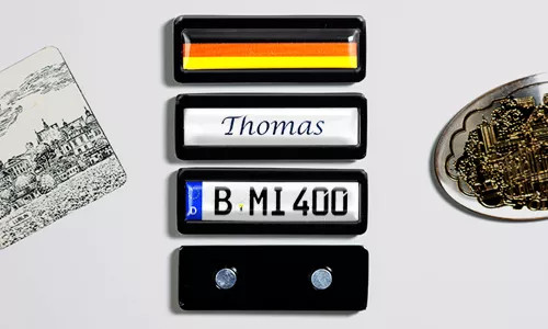 license plate magnet with flag and name