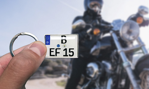 motorcycle keychain in hand