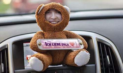 Cuddly toy with photo in the car
