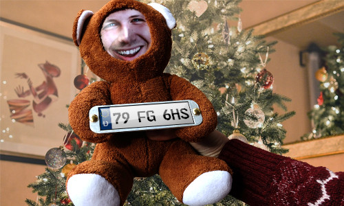 Cuddly toy with photo with license plate