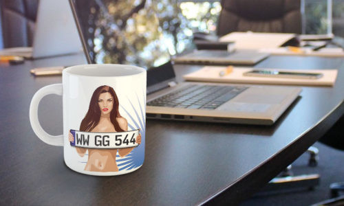 Sexy mug by a laptop