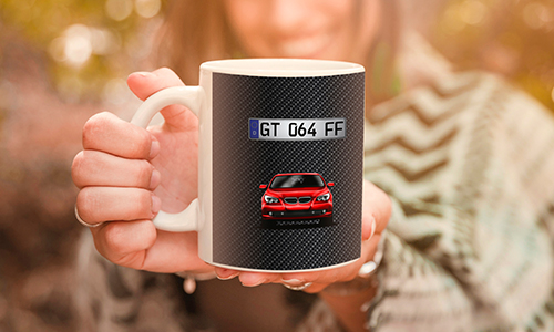 car mug with a woman in the background