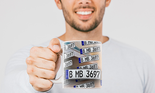 license plate mug in a man's hand